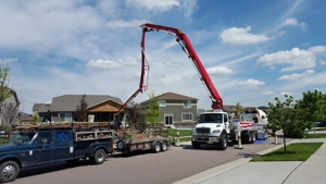 Concrete Trucks in Front of Houses